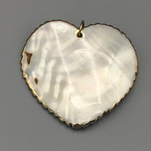 Jewelry - Mother of Pearl Pendant with gold overlay.